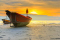 Fishing boat on a beach of thailand under sun set Royalty Free Stock Photos