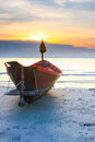 Fishing boat on a beach of thailand under sun set Royalty Free Stock Photo