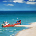 Fishing boat beached and blue sky Royalty Free Stock Photography