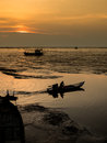 Fishing boat coming back home sunset Stock Photo