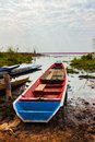 Fishing boat finish is moored on canal bank of a marsh in thailand Stock Photos