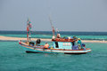 Fishing boat fishing in the open sea for a big fish Royalty Free Stock Photo