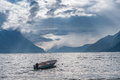 Fishing boat floating on water on fjord Royalty Free Stock Photo