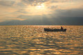 Fishing boat at garda lake romantic mood at sunset Stock Photos