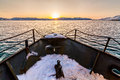 Fishing boat going to sea at winter Royalty Free Stock Photo