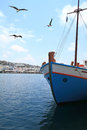 Fishing boat in the harbor of mykonos island greece Royalty Free Stock Photos