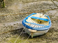 Fishing boat in a harbour during outflow Royalty Free Stock Photo