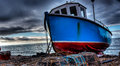 Fishing boat hdr image of a on the beach Royalty Free Stock Images