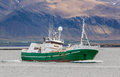 Fishing boat the icelandic offshore long line páll jónsson gk approaching port in the city of reykjavik iceland Royalty Free Stock Image
