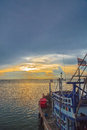 Fishing boat moor at harbor on sunrise Royalty Free Stock Photography