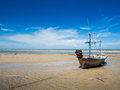 The fishing boat moored at the beach. Royalty Free Stock Photo