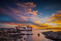 Fishing boat moored on the beach at sunset Royalty Free Stock Photo
