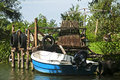 https---www.dreamstime.com-stock-photo-retro-fishing-boat-moored-street-image107168112