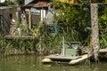 Fishing boat moored to fishing hut