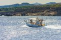 Fishing boat off the coast of the island of Rhodes, Greece Royalty Free Stock Photo