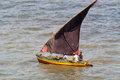 Fishing boat returning home maputo mozambique feb a small dhow to shore seen on feb near maputo in mozambique Royalty Free Stock Image