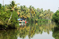 Fishing boat on the river near kollam kerala backwaters india Stock Image