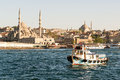 Fishing boat sails on the golden horn in istanbul turkey Stock Photo