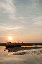 Fishing boat on a sea coast at the sunrise in morning Royalty Free Stock Photography