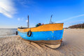 Fishing boat standing on the sand at the beach in niechorze poland Stock Photos