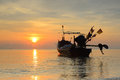 Fishing boat with sunrise backdrop asia background Royalty Free Stock Photo