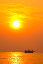 Fishing boat in sunset silhouette Stock Image
