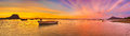 Fishing boat at sunset time. Le Morn Brabant on background. Panorama Royalty Free Stock Photo