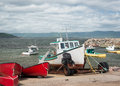 Fishing boat on trailer a sitting a next to a harbour Royalty Free Stock Photo