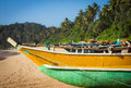 Fishing boat on a tropical beach Royalty Free Stock Photo