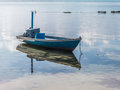Fishing boat in the water with reflection Royalty Free Stock Photo