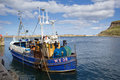 Fishing boat in whitby harbour small wooden docked Royalty Free Stock Photo
