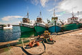 Fishing boats at anchor in a small harbor ocean bay Stock Image