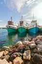 Fishing boats at anchor in a small harbor ocean bay Stock Photos