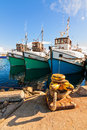 Fishing boats at anchor in a small harbor ocean bay Stock Photo