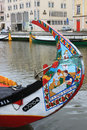 Fishing boats in aveiro canal portugal april colorfully painted prow of decorated seaweed collecting boat docked central on Stock Image