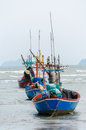 Fishing boats at bay in rainy day. Royalty Free Stock Photo