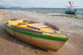 Fishing boats on the beach boat out in morning Stock Image