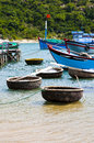 Fishing boats and coracles in the bay at binh thuan vietnam Royalty Free Stock Photography