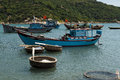 Fishing boats and coracles in the bay at binh thuan vietnam Stock Photo