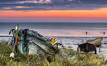 Fishing boats at dawn baltic sea latvia view on sandy beach and old boat near fisherman village in county of kurzeme Stock Photo