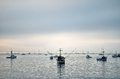 Fishing boats at dawn under a clouded sky on port san luis Royalty Free Stock Photo