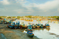 Fishing boats docked in harbor at sunset Royalty Free Stock Images