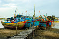 Fishing boats docked near the jetty at sunset Royalty Free Stock Image