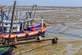 Fishing boats at ebb tide waiting for the flood thailand Royalty Free Stock Photography