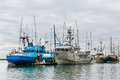 Fishing boats in a harbour overcast day Royalty Free Stock Image
