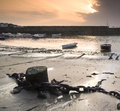 Fishing boats in harbour at sunrise long exposure image Stock Photo