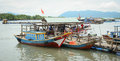 Fishing boats have a rest at the city river port in Vietnam Royalty Free Stock Photo
