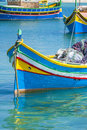 Fishing boats in marsaxlokk malta traditional multi colored the harbor of foreground focus Royalty Free Stock Images