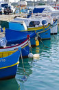 Fishing boats in the marsaxlokk village on new years day Stock Photography