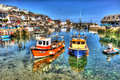 Fishing boats Mevagissey harbour Cornwall uk clear blue sea and sky in summer day in vibrant and colourful HDR Royalty Free Stock Photo